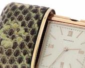 Travel Movado Watch in Snake Skin Case Metal Dore
