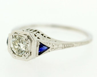 18K Gold Ring with Trillion cut Sapphire and Diamond Center