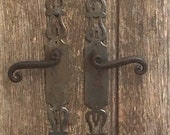 A pair of rustic chippy vintage French solid metal doorhandles and thier original fingerplates architectural salvage