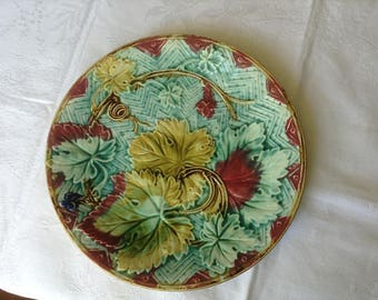 French majolica plate from Onnaing 1880. This is a collectible hand painted piece of barbotine.