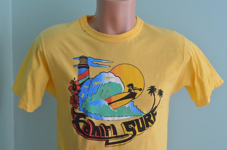 22ba649058f53 Vintage 80s T-Shirt Tahiti Surf Tropical Ocean Beach Seaside Scene Surfing  Lighthouse Palm Trees Small Yellow Tee