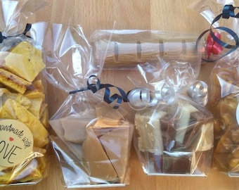 Selection box of homemade sweets. Peanut brittle, honeycomb, butter toffee, chocolate bar and fudge. Confectionery. Handmade treats