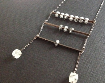 tourmaline rutilated quartz on antiqued silver with gemstone tassels 3 bar suspension necklace