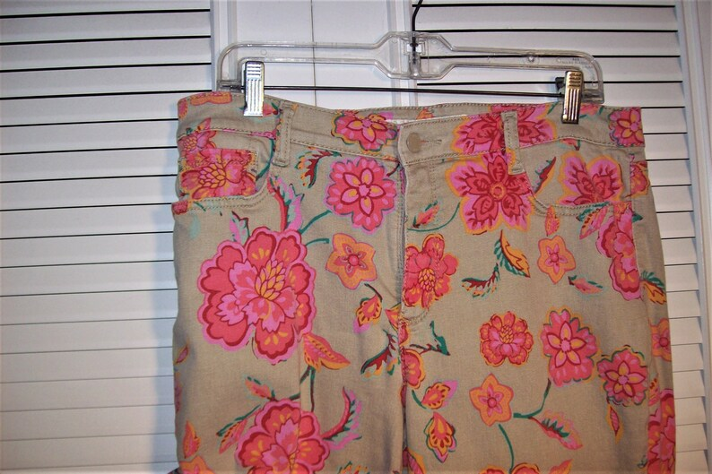 Capris 14 Jeans 14 Pants 14 see details Slightly Tapered Denim Floral Stretchy Jeans by Jones New York Jean Features