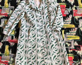 1970s green novelty coat rain coat novelty print