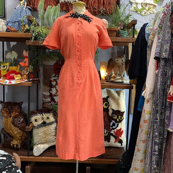 1950s orange wiggle dress with button back and pol