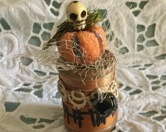 Skull and pumpkin vintage spool figure