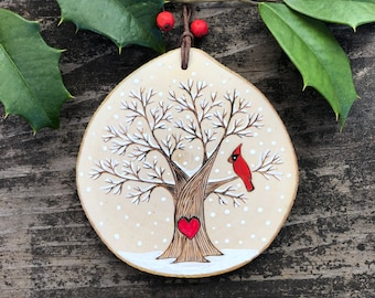 Snowy, winter tree with red cardinal and heart. Custom made, personalized wood slice ornament. Handmade by Forage Workshop PREORDER