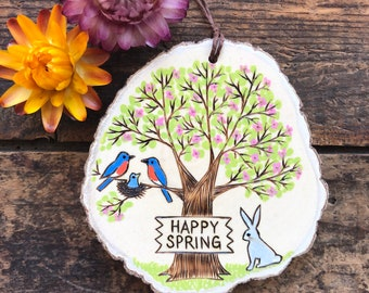 PREORDER Happy Spring wood slice ornament or magnet. Wooden sign on spring tree with blue bird family and bunny. Handmade by Forage Workshop