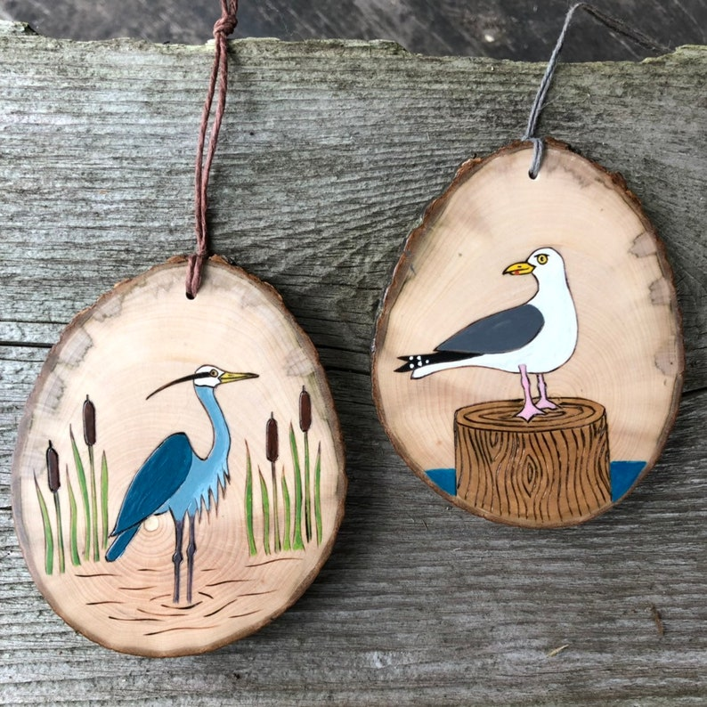 Great blue heron wood burned and painted on wood slice Bird ornament.