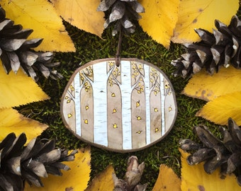 Wood burned autumn birch or aspen trees. Yellow leaves falling from aspen grove wood slice ornament, wall hanging or magnet.