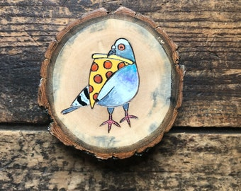 Pizza pigeon magnet. Wood burned and painted rock dove with a slice of pepperoni. Wood slice magnet. Handmade by Forage Workshop.