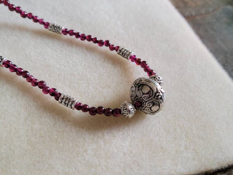 Garnet and silver princess length beaded necklace 17.75 inches.