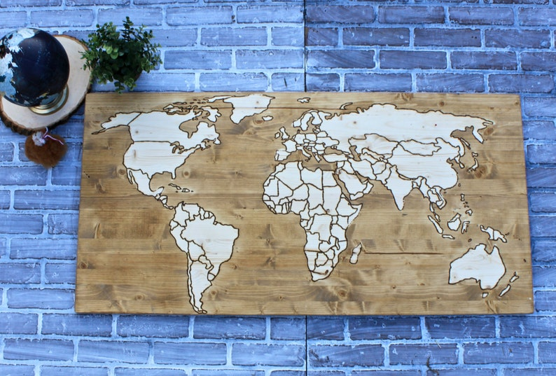 World map with wood burned outlines on one piece