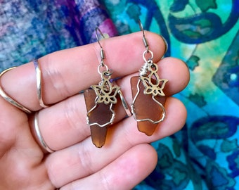 Caribbean Sea Glass Silver Wire Wrapped Tarnish Resist Earrings with Hypoallergenic Post and Brown Sea Glass. Silver Lotus Charm.