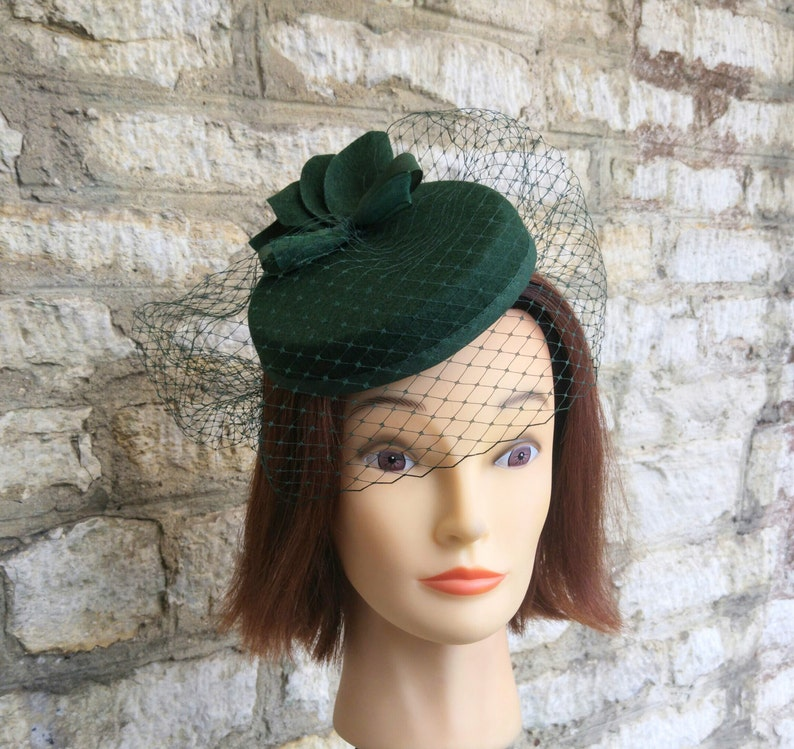 ea28d469ce396 Pillbox hat with veil dark green cocktail hat and fascinator