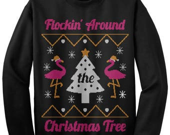 more colors flocking around the christmas tree flamingo ugly christmas sweater