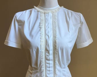 Vintage 1960s - women's pinup rockabilly white short sleeve polyester pleated fringe button secretary top / blouse - M / L - up to 40 bust