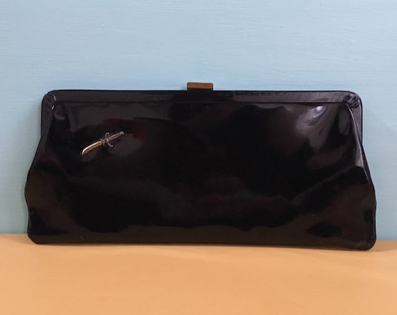Vintage 1950s / 1960s - pin up rockabilly large black patent leather rectangular clutch bag / purse - small military metal dagger detail