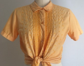 Vintage 1950s / 1960s - women's rockabilly light orange short sleeve button up top blouse shirt - eyelet lace - Small - 34 bust