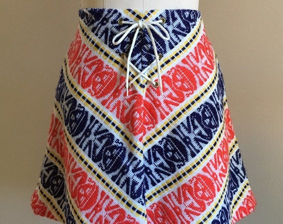 Vintage 1960s / 1970s - women's fall boho blue, yellow, red & white woven wool tribal print lace up mini skirt - M medium - 28 waist
