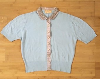 Vintage 1950s - women's short sleeve light blue cardigan sweater - mauve satin with rhinestones & beads trim - L Large - 40 bust 32 waist