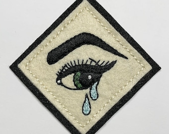 Film noir pinup girl crying eye patch