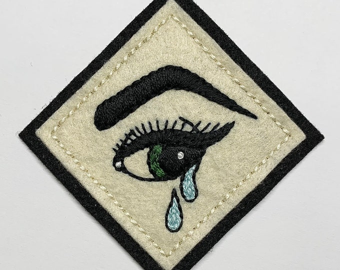 Featured listing image: Film noir pinup girl crying eye patch