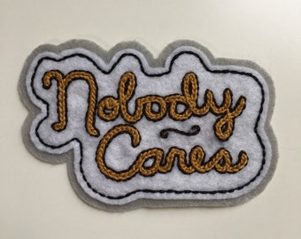 Handmade / hand embroidered white & grey felt patch - 'Nobody Cares' - cursive lettering - vintage style - traditional tattoo