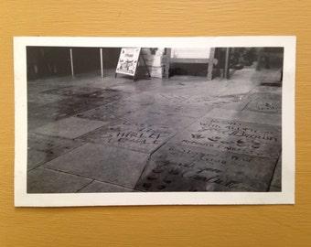 Vintage 1950s - black & white tourist souvenir photo - Grauman's Chinese Theatre Hollywood - celebrity handprints