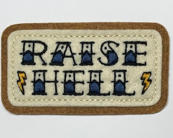 'Raise Hell' tattoo lettering with bolts patch