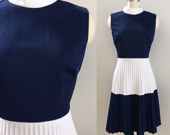 Vintage 1970s - women's sleeveless blue and white color block fit & flare polyester dress - pleated skirt - Small Medium - 36 bust 28 waist