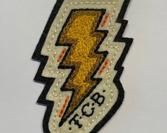 Yellow & gold TCB lightning bolt patch