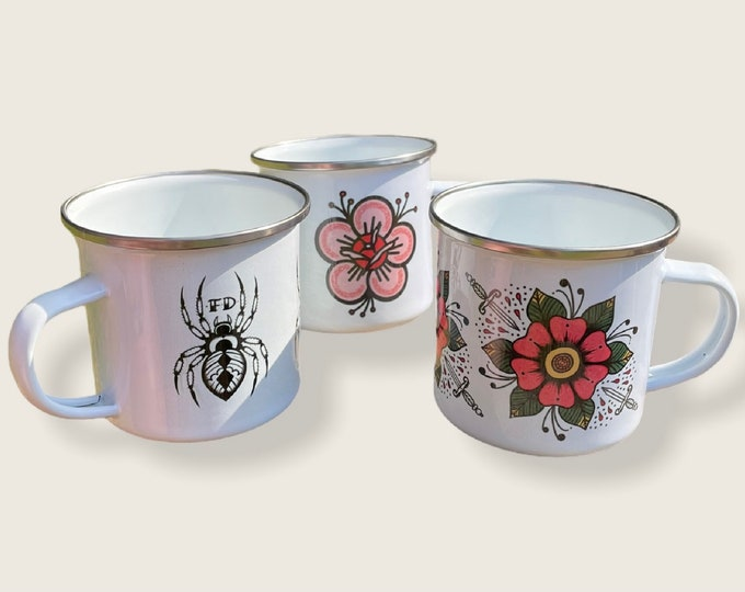 Featured listing image: Fast Doll indoor / outdoor white enamel coffee or tea mugs - pink flower, spider, flower & daggers