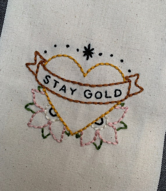 Handmade / hand embroidered off-white & gray cotton kitchen towel - 'Stay Gold' heart with banner and flowers - traditional tattoo style