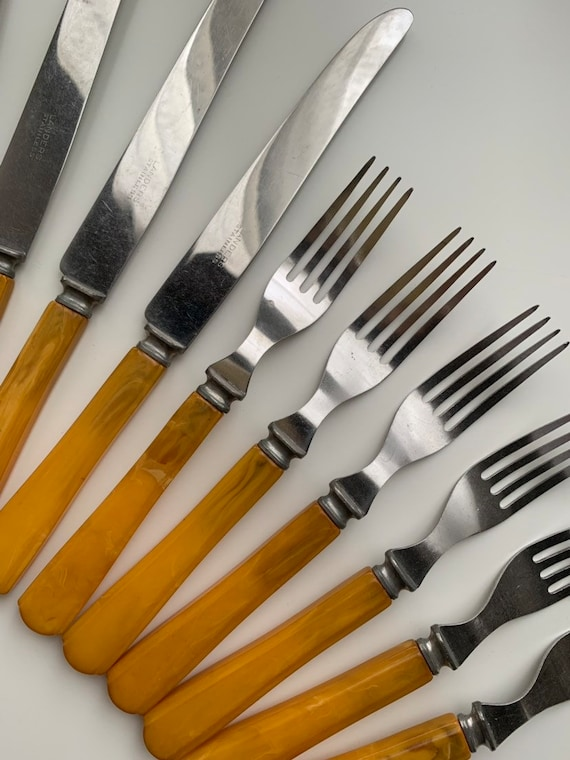 1950s - set of 12 never used stainless steel knives & forks - yellow Bakelite handle