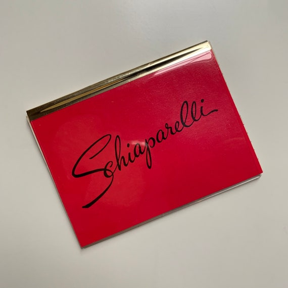 1950s - unused shocking pink Schiaparelli ID, size & info card with plastic sleeve