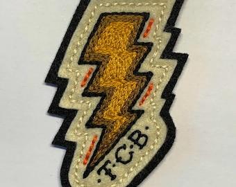 Yellow & gold TCB lightning bolt patch