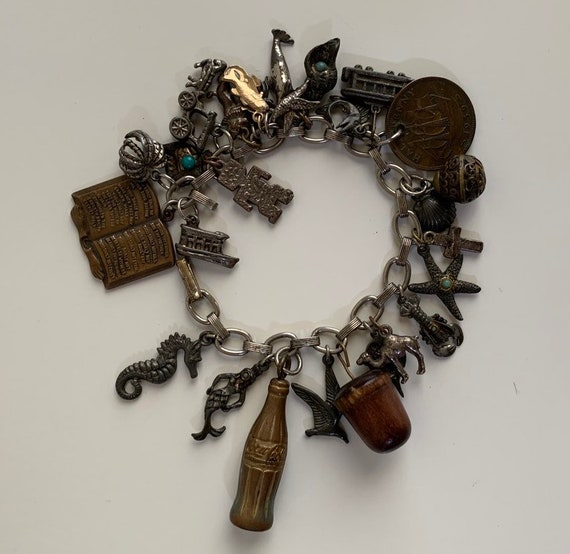 1940s / 1950s - women's silver cable chain charm bracelet - over 25 charms - beach, travel, Coca Cola bottle, coins