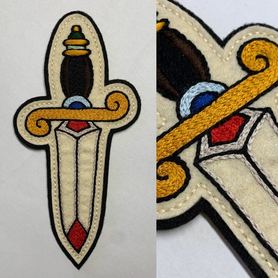 Long dagger with gold hilt handle patch
