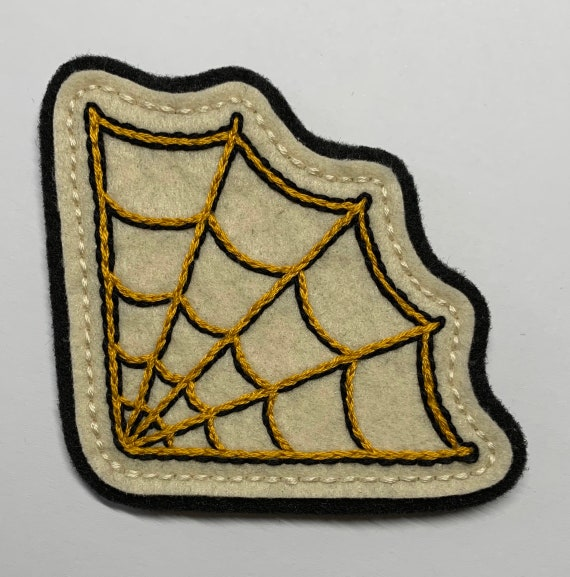 Large corner spider web patch