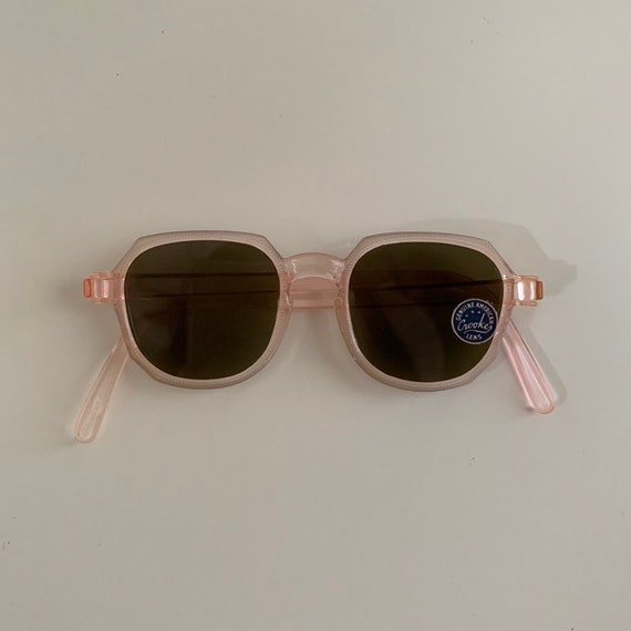 1940s - women's pink plastic rounded frame Crookes sunglasses with original tag