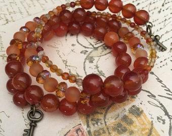 Item 527    Orange, Topaz, & Amber Memory Wire Bracelet