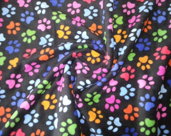 "Paw Print on Black - Polar Fleece Fabric - Metre/Half - Anti Pil - 150cm (59"") wide"