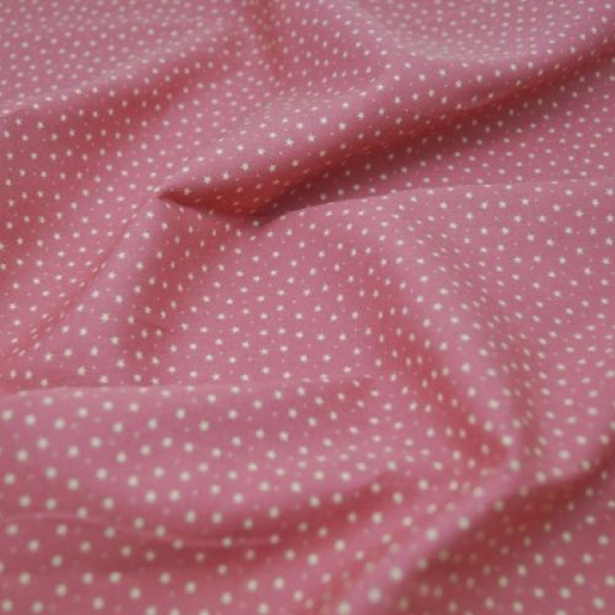 one metre cotton poplin in lilac with 3mm white spots
