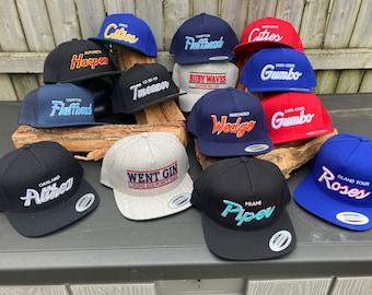 Notable Numbers Script Hat ; 7 logos