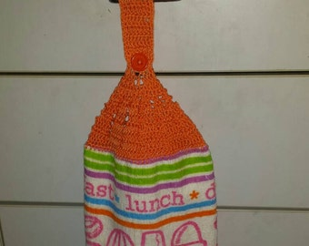 """Kitchen tea  towel with crocheted top and kitchen utensils print reads"""" breakfast  lunch  dinner """""""