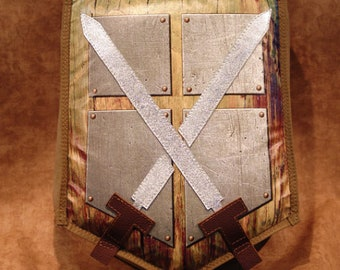 Pillow with Cross Swords Design and Handles and Shoulder Strap