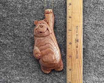 Hang in there bear ornament This artist created 5 inch original bear ornament has been hand carved from the wood of the Butternut tree.