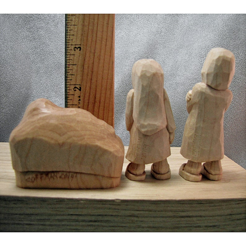 Body language shows they are a little hesitant to get closer. This Nativity or Creche has Baby Jesus and two children standing back a bit